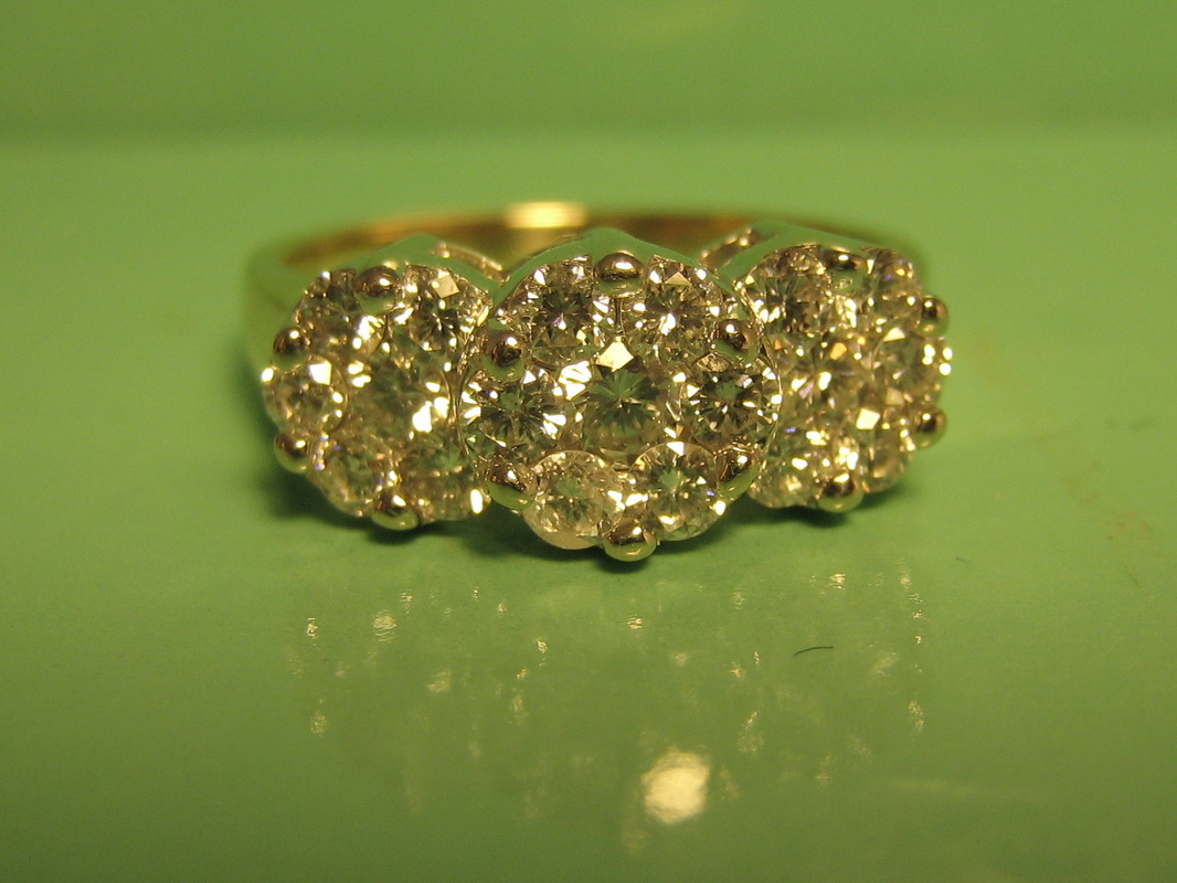 L1232G Estate 14k Lady's Ring With Approximately .66 Carats In Diamonds. VS1 to VS2 Clarity. Size 7.5 $1600