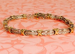Estate Jewelry Nashville Franklin TN L1981. Estate Two Tone Diamond Bracelet. 1.05 Total Carat Weight Set in 10k with 70 Diamonds. $1395.00