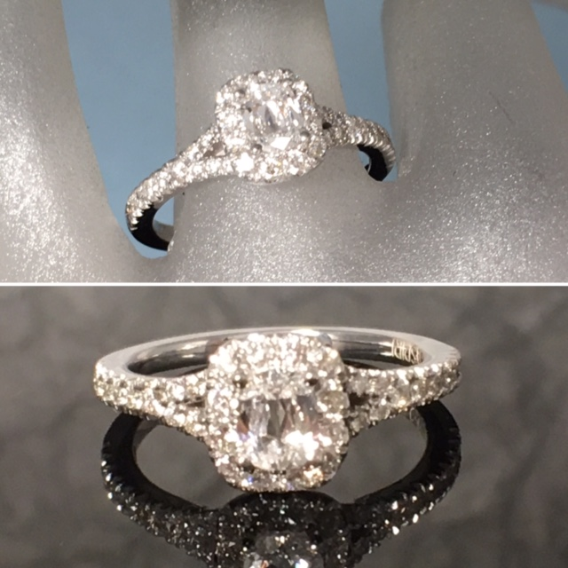 L2407. Don't Miss Out On This Fiery Oval Cut Diamond Engagement Ring. Set In 14K With Approximately 1/2 Carat Clean Oval Cut Center Diamond. This Beautiful Halo Engagement Ring Is A Size 6 3/4. It Can Be Yours For Only $2800.00.