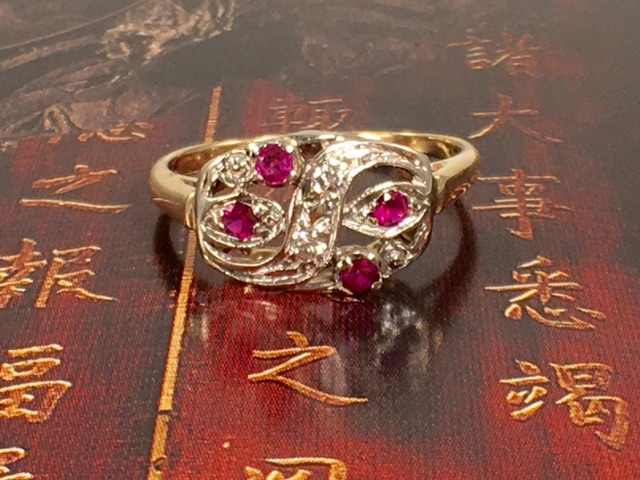 L2615. Enchanting 14 karat Art Deco ring with rubies and white topaz. $250