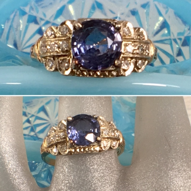 L2662. Eye catching 14k Art Deco filigree diamond and sapphire engagement ring. This lovely yellow and white gold setting supports a 1.10 cornflower blue sapphire. $1200.00
