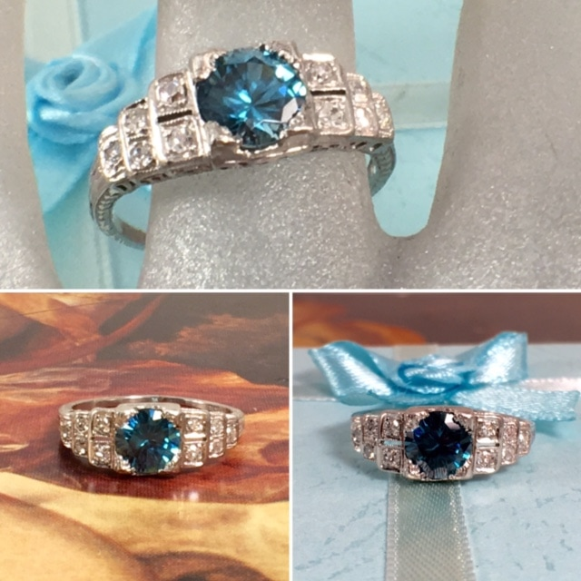 Engagement Jewelry Nashville Franklin TN L2664. Mystical platinum and approximately 1 carat natural blue zircon engagement ring. Set with diamonds in a beautiful step down setting. $1600.