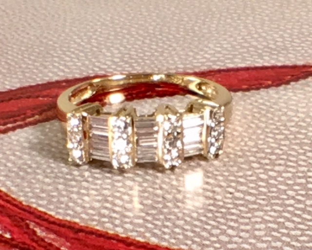 L2683. Fabulous 14k band set in 14k yellow gold with diamond baguettes and rounds. $695.000