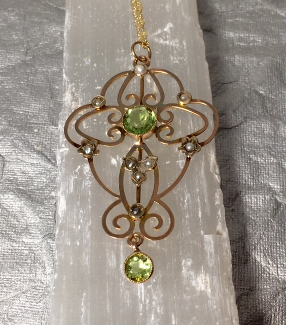 Move to Inbox More  3 of many     Print all In new window LS5300. Antique 9k Peridot Pendant With 14K Nice Chain.$350.00